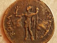 Ocenenie a určenie mince